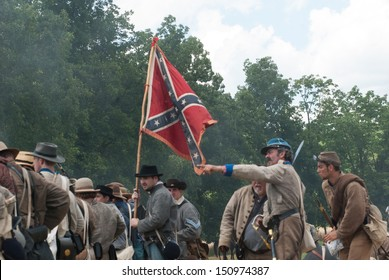 GETTYSBURG, PENNSYLVANIA- JULY 6: Confederate reenactors battle during the second day of the Reenactment of the 150th Anniversary of the Battle of Gettysburg in 2013.