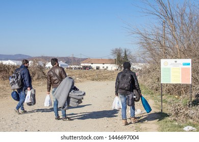 GEVGELIJA, MACEDONIA - DECEMBER 13, 2015  Refugees standing at the entrance of Vinojug camps near the city of Eidomeni Idomeni in Greece on the border with macedonia, on the Balkans Route