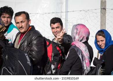 GEVGELIJA, MACEDONIA - DECEMBER 13, 2015  Refugees smiling waiting to enter Macedonia from the city of Eidomeni Idomeni in Greece on the border with Macedonia, on  Balkans Route, during Refugee Crisis