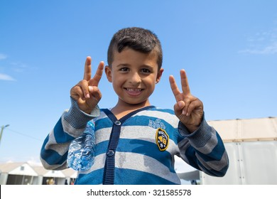 GEVGELIJA, MACEDONIA: SEPTEMBER 11, 2015: Immigrants and refugees from Middle East and North Africa in UNHCR camp. Little boy posing for camera.