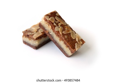 Gevulde speculaas (brown spiced biscuit), a traditional Dutch Sinterklaas/Holiday snack, on white