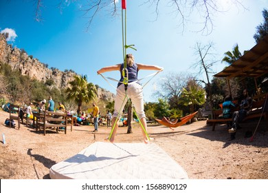 Geyikbayiri, Antalya, Turkey. March 8, 2019. Slackline and Highline Festival. Woman catches balance. Coordination exercise.