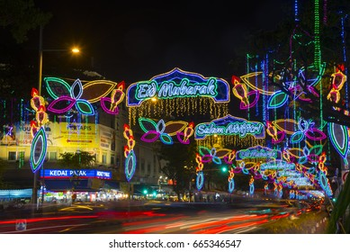 Geylang Serai, Singapore - June 22, 2017 :Busy street lightened up with colorful decorative lightings on both sides during Ramadan holy month of Muslim eid mubarak aidilfitri hari raya