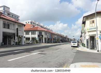 Geylang, Singapore - January 12, 2019 : View of a quiet street with old double-storey shop houses on both side of the road at Geylang Road