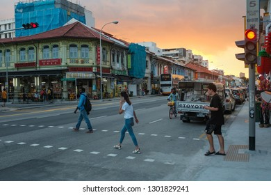 Geylang, Singapore - January 12, 2019 : Street view of a pedestrian crossing during sunset at Geyland Road