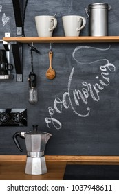 """geyser coffee maker on a chalky kitchen wall background in a loft style. The inscription """"Good Morning"""" with chalk in the form of steam from hot coffee."""
