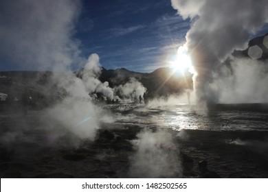 Geyser del Tatio, Atacama Desert, Chile - July 25th, 2015: Geyser in the morning erupting activity in the Geysers del Tatio field in the Atacama Desert, Chile.
