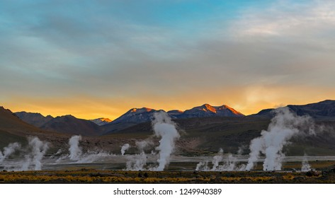 The geysers of the El Tatio geyser field, the highest in the world at 4320m altitude, at sunrise in the region of San Pedro de Atacama and the Atacama desert, Chile.