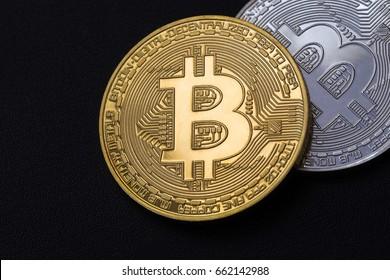 ggolden and silver bitcoin on dark textured background