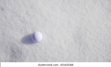 Ggolf ball on the snow.