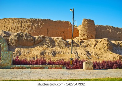 Ghal'eh Jalali mud fortress is surrounded by flower beds and recreational zone of public Mellat park, Kashan, Iran