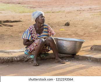 Ghana, Accra - January 02, 2017: African Ghana woman waiting to take water at the well in Accra, Ghana
