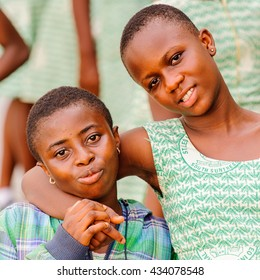 GHANA, ACCRA - MARCH 2, 2012: Portrait of two friends from the Saint Leo International School who came to see the Elmina Castle in Accra, Ghana Children from all faiths may study in the St Leo School.
