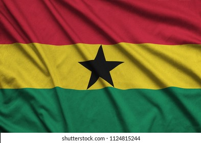 Ghana flag  is depicted on a sports cloth fabric with many folds. Sport team banner