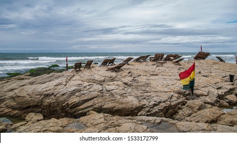 Ghana flag on beach cliffs in Tema located outside Accra Ghana West Africa.