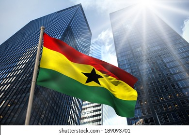 Ghana national flag against low angle view of skyscrapers