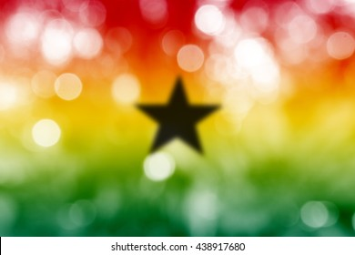GHANA : National flag. Soft blurred bokeh natural background. Abstract gradient desktop wallpaper.