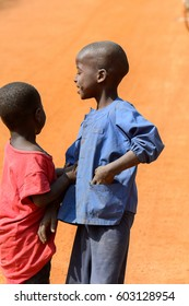GHANI, GHANA - JAN 14, 2017: Unidentified Ghanaian little boy holds the other by the hand in a local village. Ghana people suffer of poverty due to the bad economy.