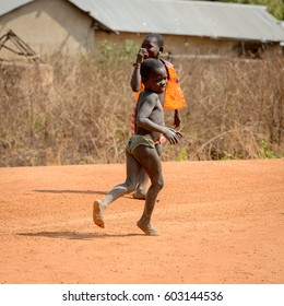 GHANI, GHANA - JAN 14, 2017: Unidentified Ghanaian children play on the road in a local village. Ghana people suffer of poverty due to the bad economy.