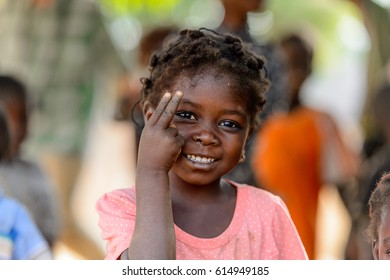 GHANI, GHANA - JAN 14, 2017: Unidentified Ghanaian little girl shows her fingers in the Ghani village. Ghana children suffer of poverty due to the bad economy.