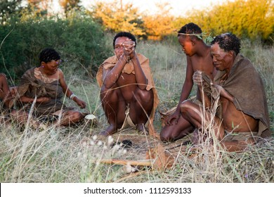 GHANZI, BOTSWANA - MAY 14: san bushman show people how they light a fire in  the kalahari desert in botswana may 14, 2017 in Ghanzi, Botswana