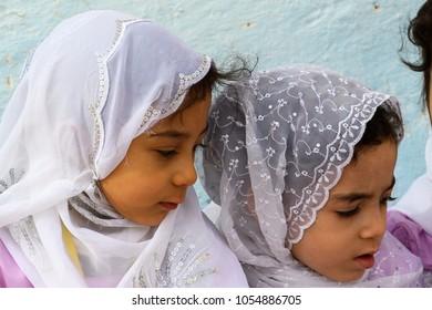 GHARDAIA, ALGERIA - MARCH 6, 2018:  Unidentified little girls in traditional clothes in the local kindergarten in Algeria