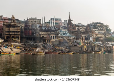 The Ghats on the shore of the holy Ganges river during a misty morning. Varanasi, Uttar Pradesh, India. Photo taken on 7th July 2018.