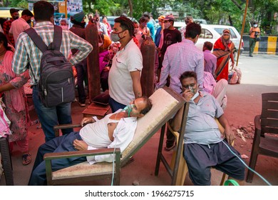 Ghaziabad, Uttar Pradesh, India- May 1 2021: Covid-19 patient getting free oxygen, India facing shortage of medical oxygen, in this situation NGO Khalsa Help International helping covid-19 patient.