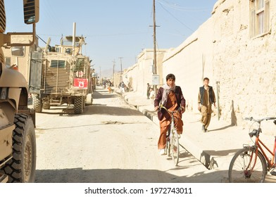 GHAZNI, AFGHANISTAN - November 22, 2010: An international Security Assistance Forces (ISAF) patrol consisting of heavily armored vehicles makes its way through the roads of an Afghan village.