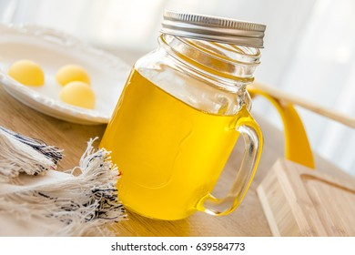 Ghee or clarified butter in jar close up