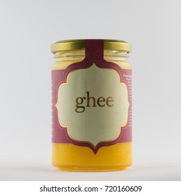 Ghee in a jar. Lactose Free Butter on white backgroud
