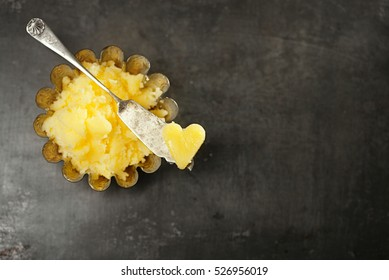 ghee or melted butter on baking paper in mold