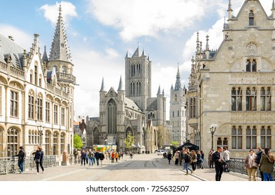 GHENT, BELGIUM - APRIL 16, 2017: View of the ancient bridge of Saint Michael, old post office and church of St. Nicholas in the historical center of Ghent, Belgium