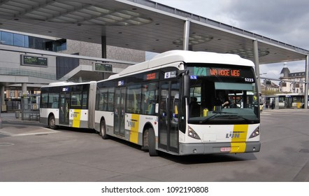 Ghent / Belgium - April 30 2016: A flemish De Lijn VanHool gelede city bus in Ghent departs from the busstation.