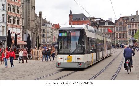 Ghent / Belgium - April 30 2016: A flemish De Lijn modern tram in the old inner city of Ghent