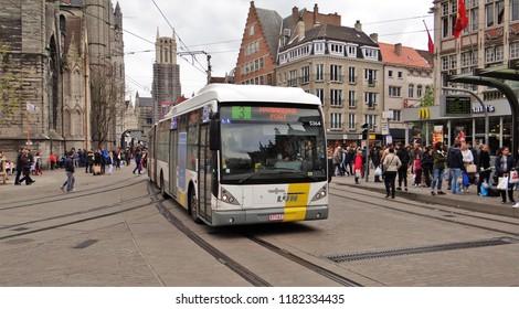 Ghent / Belgium - April 30 2016: A flemish De Lijn VanHool gelede city bus in the old inner city of Ghent