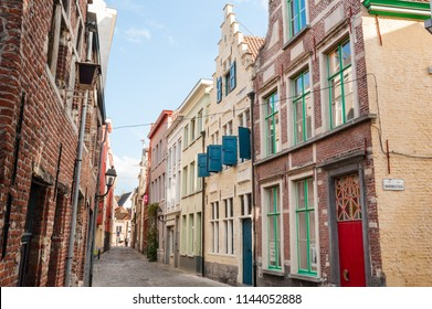 GHENT, BELGIUM. Aug. 4, 2015. Narrow cobbled street in Patershol in historical city center of Ghent, Belgium.