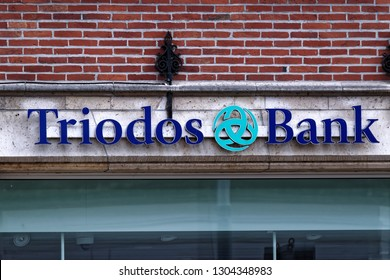 Ghent, Belgium - August 12, 2018: Triodos Bank branch with typical logo and colors.
