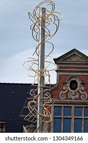 Ghent, Belgium - August 12, 2018: Art installation from unique gilded metal shapes in the historic part of Ghent, Belgium.