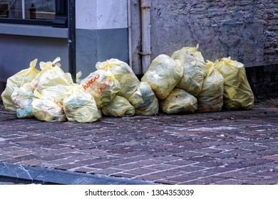 Ghent, Belgium - August 12, 2018: Garbage bags stacked and ready to be picked.