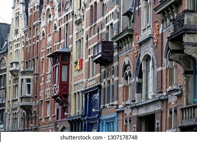 Ghent, Belgium - August 12, 2018: View from the exterior facade of a historic building. Readable word translated from Dutch to English: Iron, Connects, Steel, Bank beams.