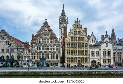 Ghent / Belgium — August 17, 2015: view of the Graslei quay on the Lys (Leie) river in Ghent with tower of former post office and Vrije Schippers Guildhall, Tweede Korenmetershuis and Spijker houses