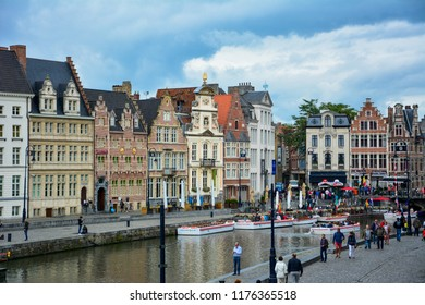 Ghent / Belgium — August 17, 2015: view of the Korenlei quay on the Lys (Leie) river in the center of Ghent. Ghent is famous for its well-preserved historic center with small medieval houses