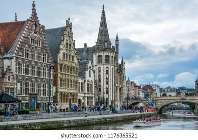 Ghent / Belgium — August 17, 2015: view of the Graslei quay on the Lys (Leie) river in the center of Ghent with buildings of former post office, Vrije Schippers Guildhall and Tweede Korenmetershuis