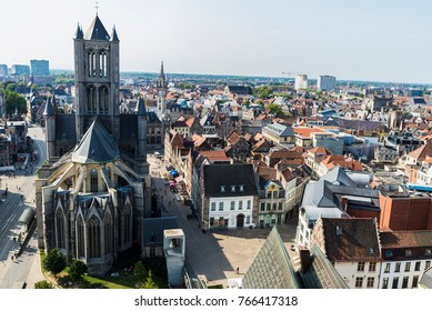 Ghent, Belgium - August 29, 2017: View of the Saint Nicholas Church with people walking in the old town of the medieval city of Ghent, Belgium