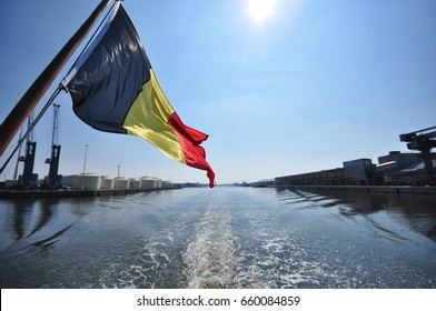 Ghent, Belgium: Belgian flag flying through the wind on canal