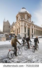 GHENT, BELGIUM - CIRCA 2010: School children cycling in winter through the streets of Ghent, Belgium