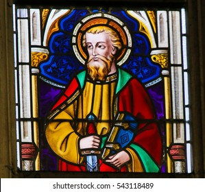 GHENT, BELGIUM - DECEMBER 23, 2016: Stained Glass window depicting Saint Paul in the Cathedral of Ghent, Flanders, Belgium.