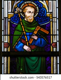 GHENT, BELGIUM - DECEMBER 23, 2016: Stained Glass depicting Saint Joseph holding a lily and carpentry square, in the Cathedral of Saint Bavo in Ghent, Belgium.