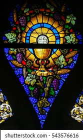 GHENT, BELGIUM - DECEMBER 23, 2016: Stained Glass window depicting the Eucharist and the Holy Grail in the Cathedral of Saint Bavo in Ghent, Flanders, Belgium.
